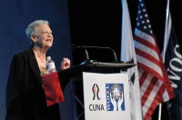 Harriet May welcomes more than 2,800 attendees during the Opening Ceremony of the The 1 CU Conference.