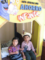 "(Photo from FENACOAC) Children's accounts are sometimes the ""hook"" to get remittance receivers to join the credit union."