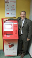 Steve Schaefer with one of the new ATMs at Santa Maria Magdalena Credit Union.