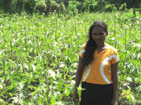 Malika Deepani with the crops that she will rely on to support her family throughout the year.