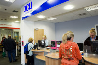 Pollok Credit Union in Glasgow, Scotland, is partnered with a local post office, offering the convenience of combined services. The manager of the credit union is the local postmaster, and the employees of both organizations are being cross-trained to better serve members and customers.