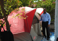 Haiti staff member stands with his tent.