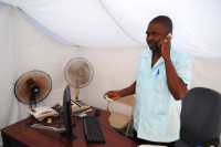 Working inside a tent office after Haiti earthquake