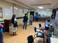 Members of a credit union in Santa Ana, Colombia socially distance in line