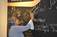 CoopeAnde Board member Nydia Durán Rodríguez puts her wishes on the MyPoint CU Wish Wall.