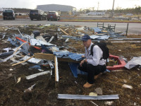 American Heritage Credit Union President & CEO Bruce Foulke amid debris from Hurricane Dorian in Freeport, Grand Bahama