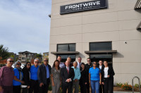 Frontwave CU staff, including CEO Bill Birnie (center in black suit), with the delegation from CoopeAnde #1.