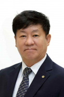 Younsik Kim, WOCCU Board Director and Chair/CEO of the National Credit Union Federation of Korea