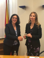 GWLN Program Director Lena Giakoumopoulos presents a WOCCU Ambassador Medallion to the Governor of the National Bank of the Republic of North Macedonia