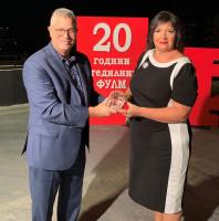 WOCCU Board Chair Steve Stapp presents a 20th anniversary gift to FULM Savings House CEO Eleonora Zgonjanin