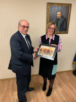 A representative of Ukraine's National Commission for the Regulation of Financial Services Markets presents World Council President and CEO Brian Branch with a plaque for WOCCU's assistance in helping them draft new financial norms.