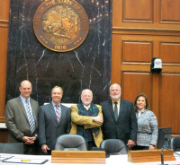 Indiana Credit Union League management visits the Indiana State House with Roland Lampe, Director of the Association of Credit Unions in the Netherlands. From the left are Chris Beaumont (ICUL), John McKenzie (ICUL), Roland Lampe (ACUN), Joe Guilfoy (ICUL) and Kay Neidlinger (ICUL).