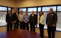 ACUN Director Roland Lampe visits with Riverside Community Federal Credit Union in Marion, Indiana. From left to right: John McKenzie (ICUL), Thomas Belekevich (WOCCU), Dan Parrie (RCFCU), Tim Moorman (RCFCU), Roland Lampe (ACUN), Kelli Kistler (RCFCU) and Joe Guilfoy (ICUL).